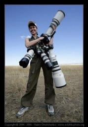 Девушка фотограф и большие объективы